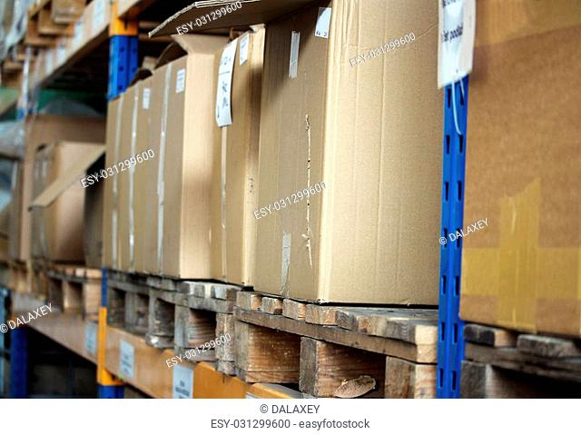 Cardboards with products in the big warehouse