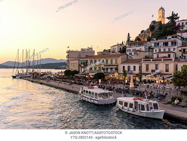 Sunset view of the waterfront of Poros Town, Poros Island, Greece