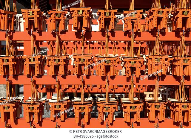 Ema wish plaques in the shape of orange torii gate, Fushimi Inari-taisha Shrine, Kyoto, Japan