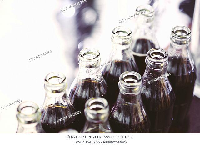 Refreshing Brown Soda in bottles in Candy Bar On Table. Delicious sweet buffet