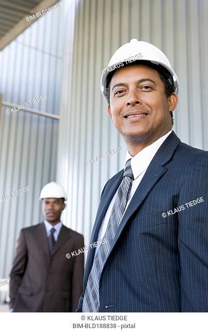 Multi-ethnic businessmen in hard-hats