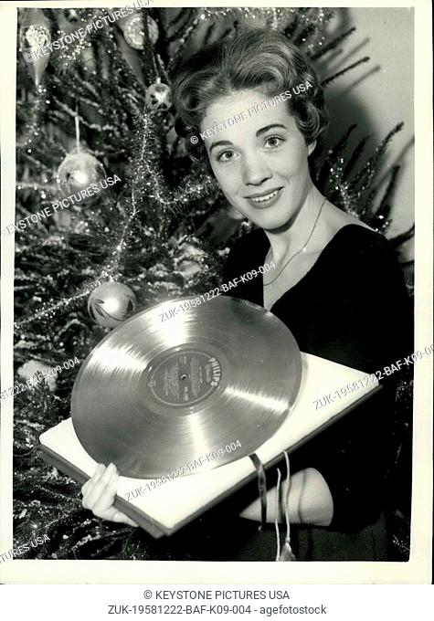 Dec. 22, 1958 - Julie Andrews with her 'Golden Disc' : Julie Andrews star of 'My Fair Lady' last evening received a 'Golden Disc' during the BBC TV programme...