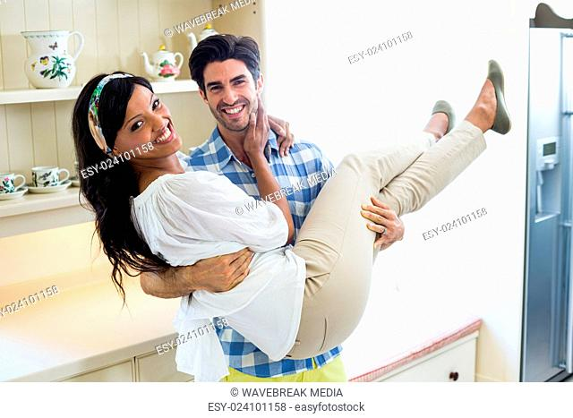 Portrait of happy young couple embracing