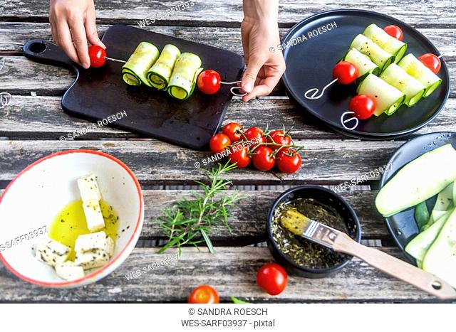 Vegetarian grill skewers, tomato and zucchini slices, sheep cheese