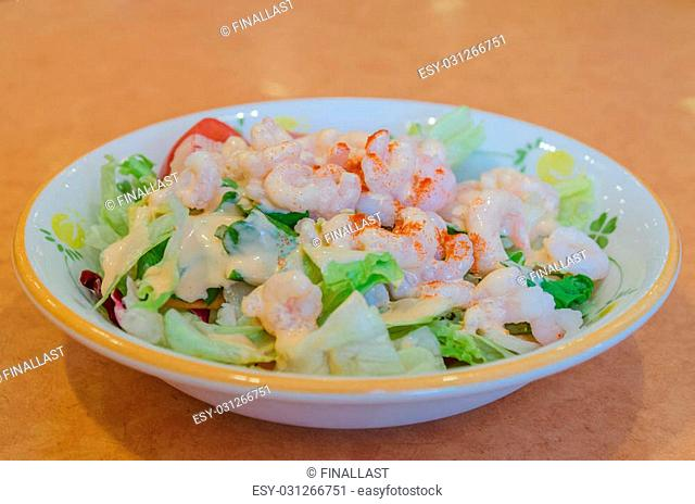 Healthy shrimp salad with mixed greens