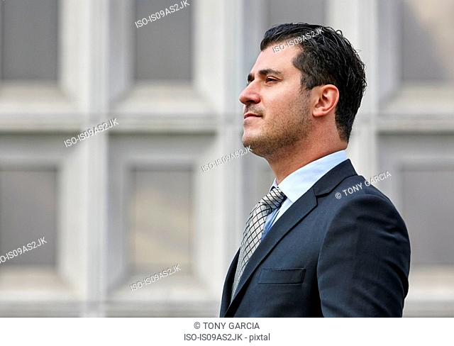 Portrait of mid adult business man looking away. side view