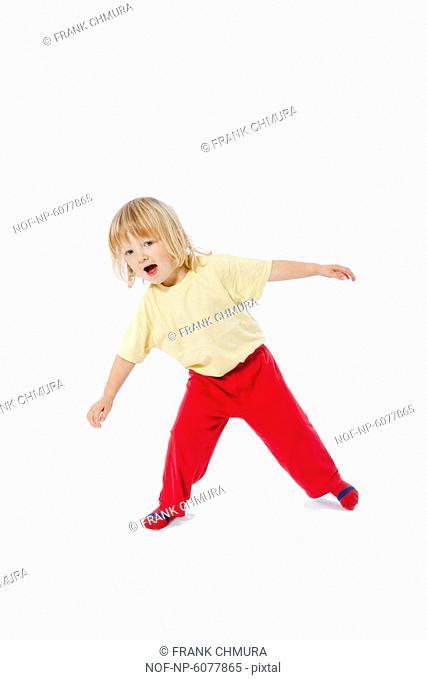Energetic 3 years old boy jumping around the floor