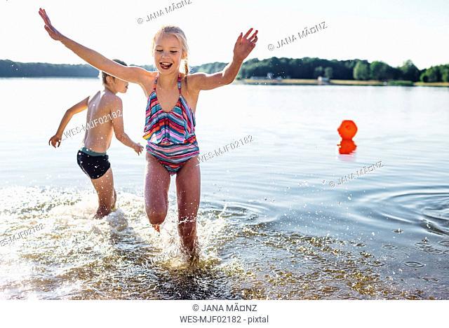 Children having fun at lakeshore