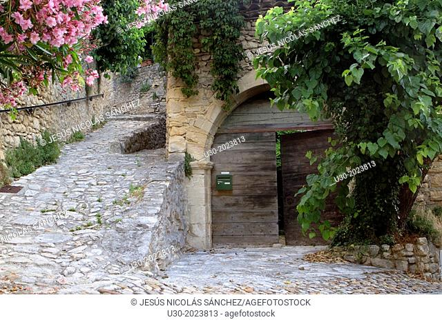 Typical paved street in Roque-sur-Ceze, labelled The Most Beautiful Villages of France. Gard deparment, Languedoc-Roussillon region. France