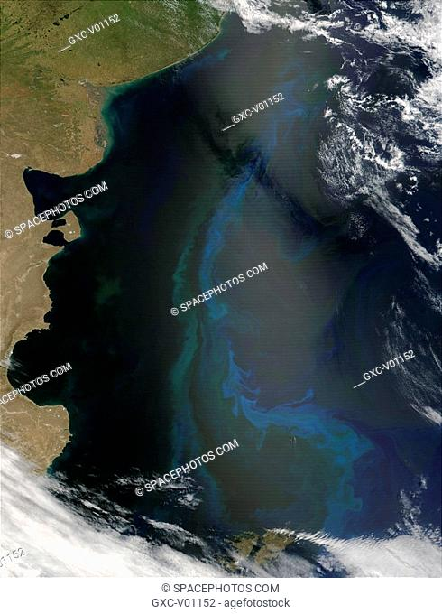 Beneath the sunglint in roughly the center of the true-color image from November 30, 2001, a nearly 800-mile long phytoplankton bloom is occurring in the South...