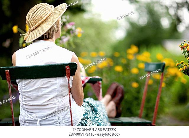 Senior in the summer garden
