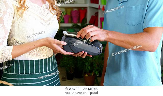 Costumer making payment through smartphone