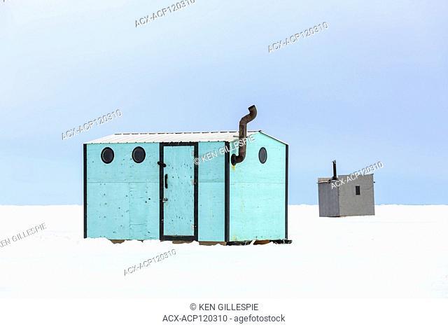 Ice fishing shacks on Lake Winnipeg, Gimli, Manitoba, Canada
