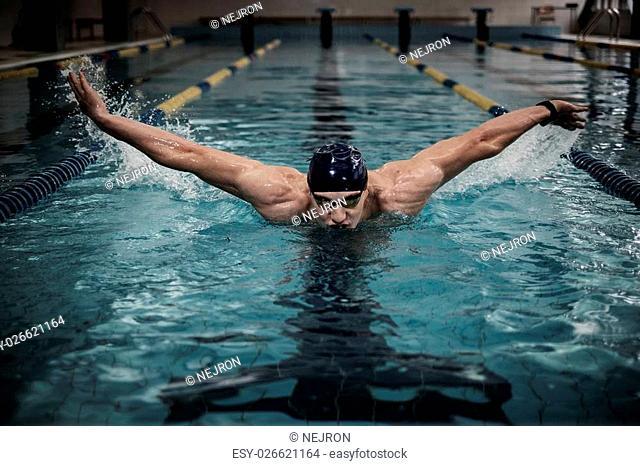 Man swims using breaststroke technique