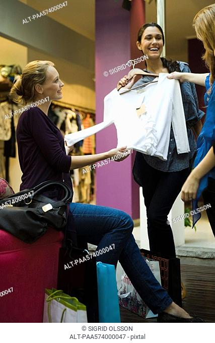 Friends shopping together in clothing store