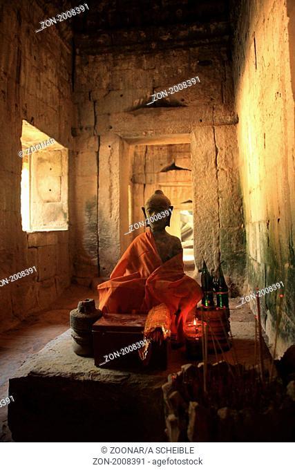 Buddha Statue at Ta Phrom temple at AngkorCambodia