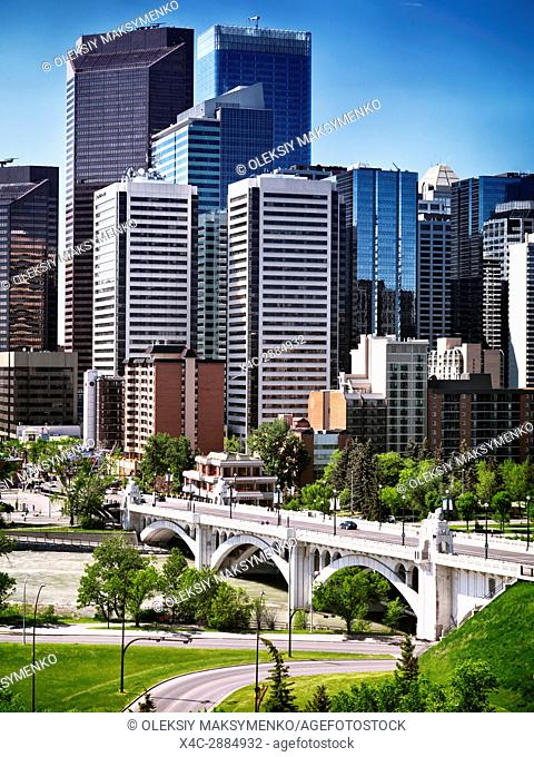 Centre Street Bridge and Calgary city downtown towers daytime urban scenery. Calgary, Alberta, Canada 2017