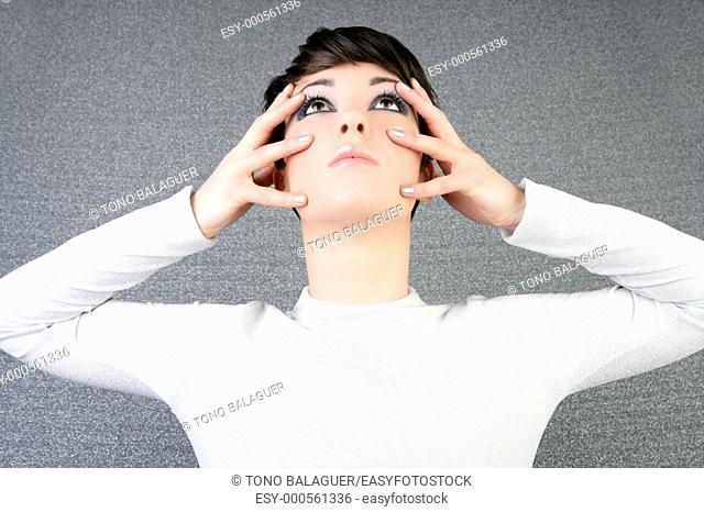 futuristic woman fashion portrait fingers on face silver nails
