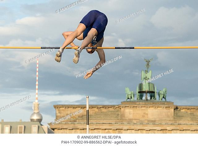 "US pole vaulter Sam Kendricks in action in front of the Brandenburg Gate during the German Athletics Association (DLV) international competition """"Berlin..."