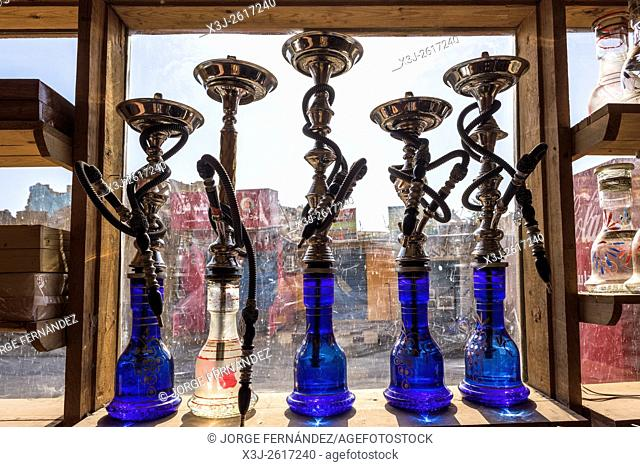 Smoking water pipes at a shop window