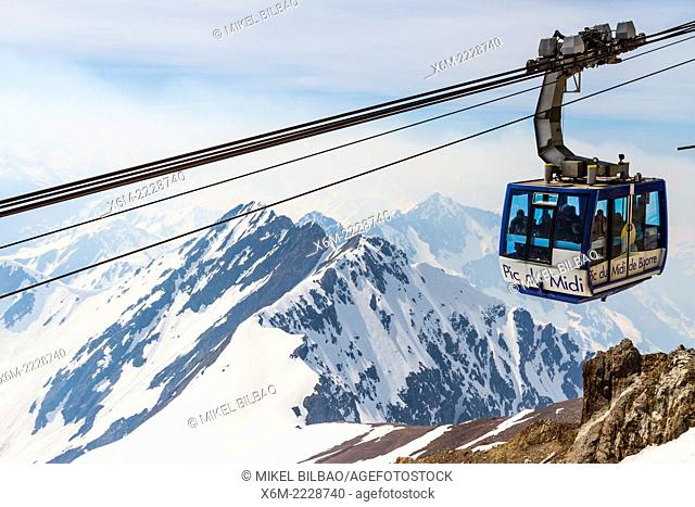 Aerial tramway and snow-covered mountains. Pic du Midi de Bigorre