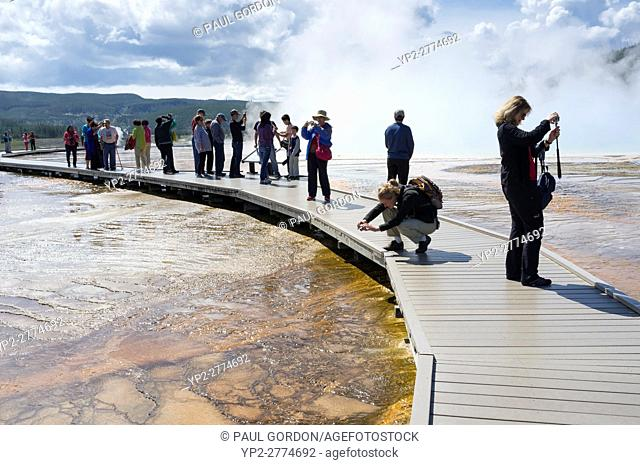 Teton County, Wyoming: Crowd of visitors taking photos at Grand Prismatic Spring in Yellowstone National Park