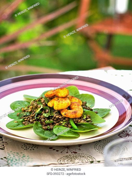 Lentil salad with breaded prawns