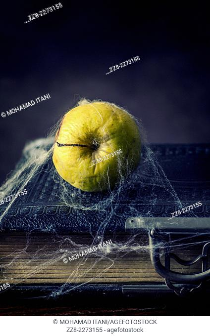 Bad apple with an old book