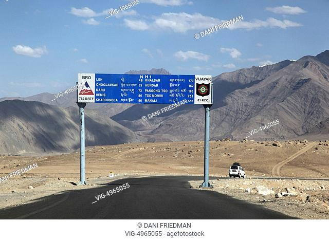 Road sign showing distances to different cities along National Highway 1 just outside the city Nimmu, Ladakh, Jammu and Kashmir, India