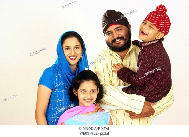 Indian Sikh Punjabi family of four from India