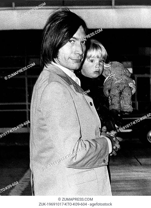 Oct. 17, 1969 - London, England, U.K. - Drummer CHARLES WATTS of the famous British rock group The Rolling Stones holds his 19-month-old daughter SERAPHINA
