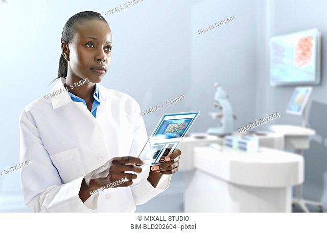 African American doctor using digital tablet in laboratory