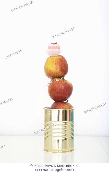 Apples and a chocolate in a tin can, preserved food