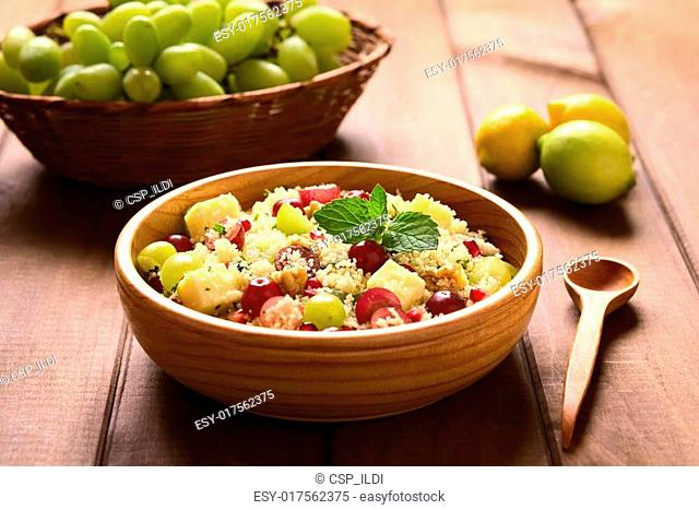 Couscous with Grapes, Pomegranate, Nuts and Cheese