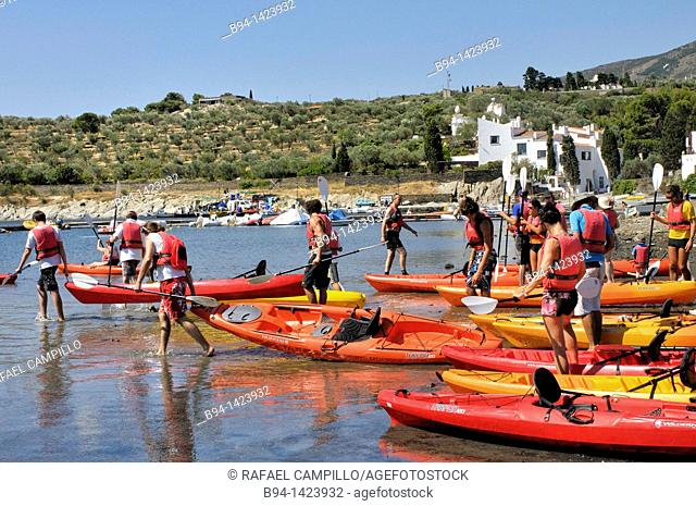 People in canoes. Casa-Museo Salvador Dalí. Port Lligat, small village located in a small bay on Cap de Creus peninsula, on the Costa Brava of the Mediterranean...