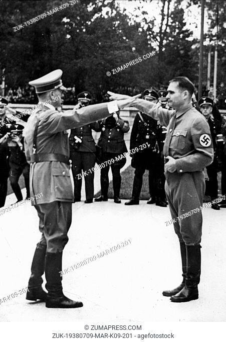 July 9, 1938 - Nuremberg, Germany - HERR RUDOLF HESS (R), Adolf Hitler's Deputy, greets the Fuehrer ADOLF HITLER with the Nazi salute