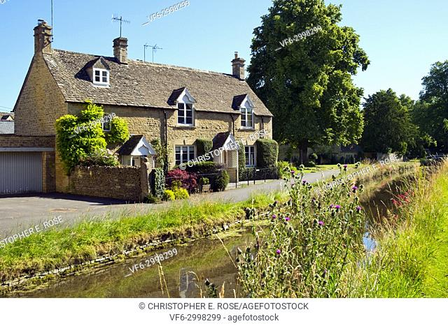 Summer sunshine in idyllic Lower Slaughter village in the Cotswolds Area Of Outstanding Natural Beauty, Gloucestershire, UK