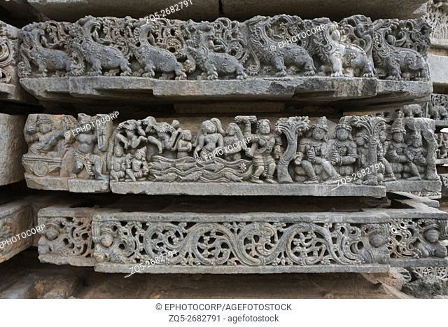 Ornate bas reliefs depicting scene from Mahabharata, Kedareshwara temple, Halebidu, Karnataka, india