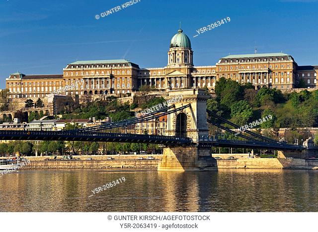 View over Danube river to Szechenyi Chain Bridge and Buda Castle on Castle Hill in the Castle District, Budapest, Hungary, Europe