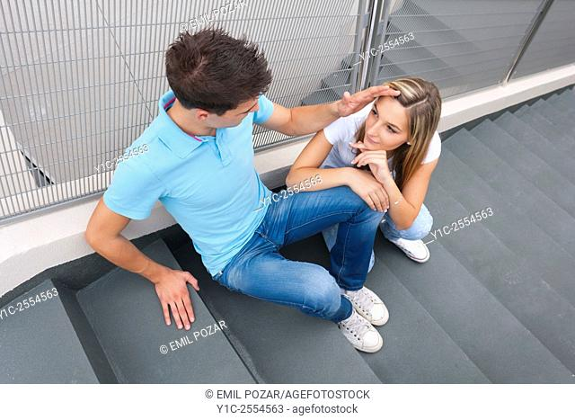 Stock Photo - Teen couple girl and boy looking each other shot from above