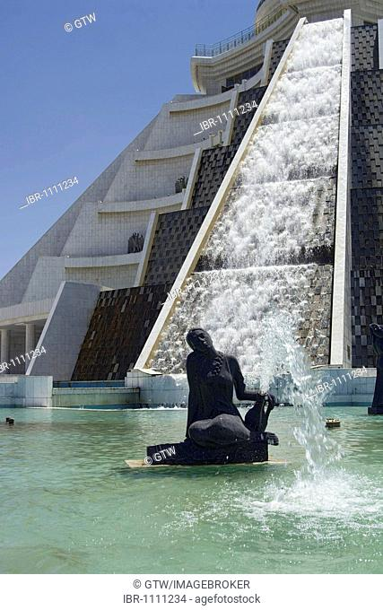 Fountain in front of a pyramid-shaped department store at Independence Park, Ashgabat, Turkmenistan