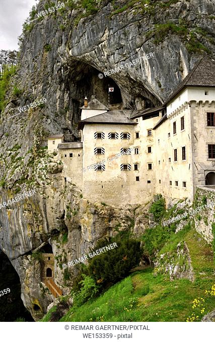 Cliff cave entrances at Predjama Castle 1570 Renaissance fortress built into the mouth of a cliffside cave in Slovenia
