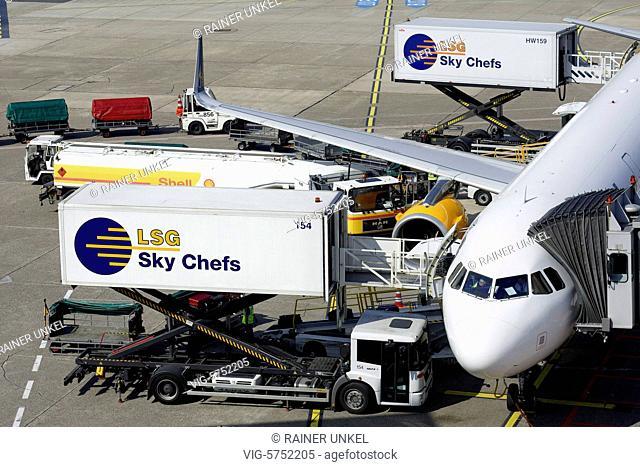 Trucks of LSG Sky Chefs are supplying a plane on Duesseldorf airport , 09.04.2017 - Duesseldorf, Northrhine-Westfalia, Germany, 09/04/2017