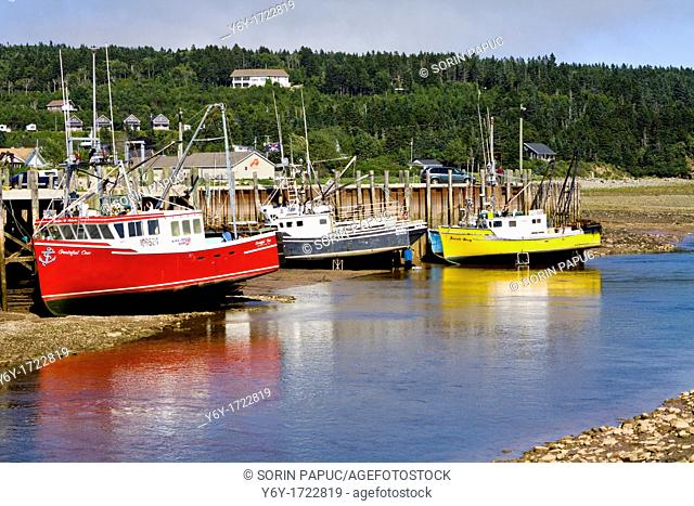 Lobster boats sitting on the seabed Bay of Fundy, Alma, New Brunswick,is known for having the highest tidal range in the world Specifically in Alma the water...