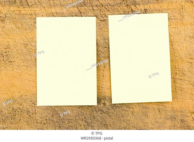 Yellow note paper on wooden background, rectangle note paper