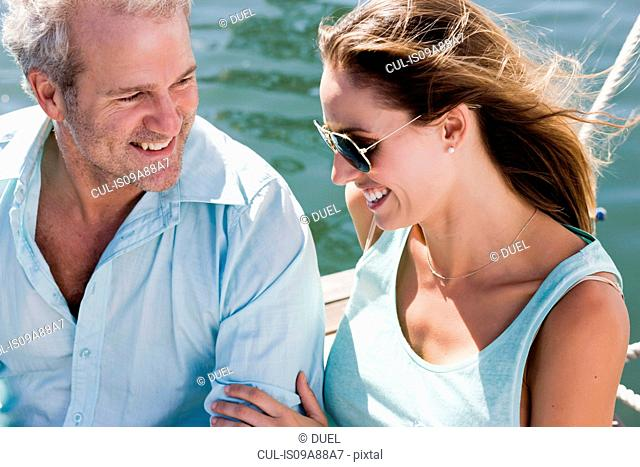 Couple on yacht, woman touching man's arm
