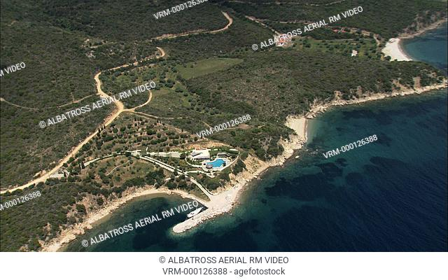 Aerial HD video of a Kambos bay in Halkidiki, with a yacht anchored in it