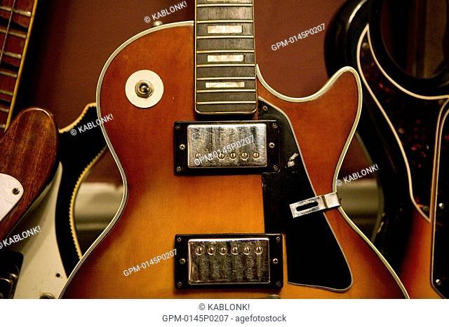 Close-up of electric guitar indoors