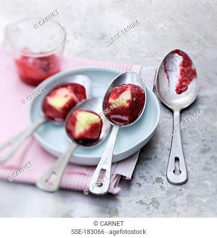 Spoonfuls of semolina pudding with raspberry jam