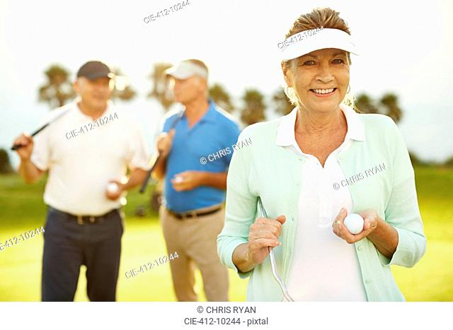Senior friends on golf course